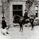 Mr Richard Cory on horseback, with Mr Pattington the coachman and the dog Venus, outside the south front door (the carriage door)  1881