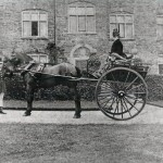 Mrs Bessie Frances Cory, in the two wheeled dog cart, with Mr John Bryant, the liveried groom, outside the east front of Langdon Court.  c. 1881