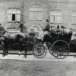 The family's four wheeled dog cart outside the east front of Langdon Court. Mr Pattington is the coachman, with passengers Frank and Mary Jervis; Mrs Coulthard; Colonel Gore; Major Nepean and Richard Cory.  Mr Bryant the groom, stands behind.  The horses are 'Duke' and 'Emperor'.   1892