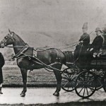 Richard Cory and his second wife, Bessie Cory, with the four-wheeled dog cart and horse. The groom, in livery and great coat, is John Bryant.  1880s