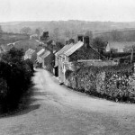 Knighton Hill, probably between 1922 and 1928. The turn to the right is the current sharp bend on the main road from Plymouth. The cottages on the right were, in the large majority of cases, rented by agricultural labourers.